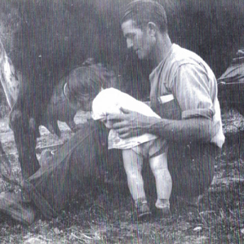 2-year old Pat with Dad, learning to milk a cow on the family farm